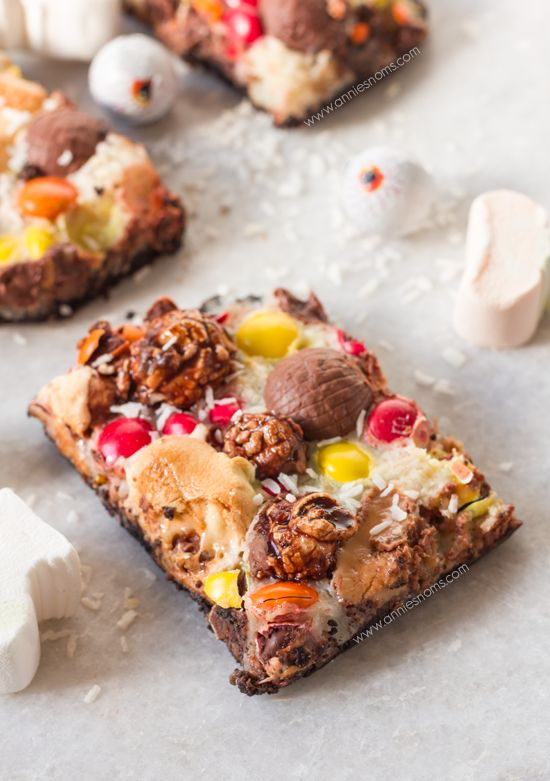 Candy Overload Magic Bars   Annie's Noms - An Oreo base is topped with condensed milk, shredded coconut and a myriad of candy creating a soft gooey, chocolatey magic bar!