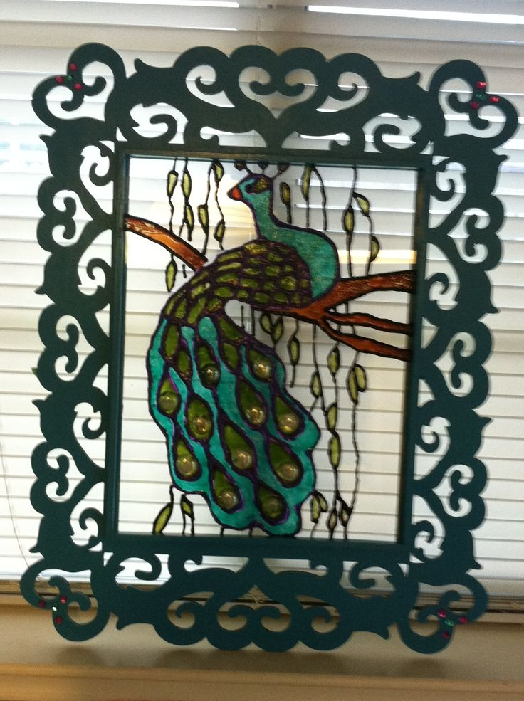 Peacock painted on glass then made frame!!