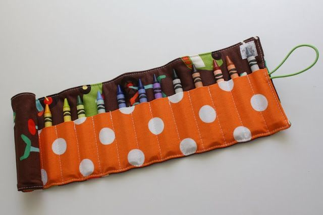 one of the long time staples in my shop used to be  crayon rolls. these are perfect for gifts! each of my girls have one and silas  has been begging for one, so i made up this adorable one for him....