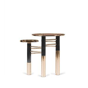 Reduced shapes and clean lines - Konstantin Side Table truly embodies what an essential piece is: an elegant look full of refinement and modernity. This side table features a brown smoked glass top with a gold trim and a gold plated tray to give extra functionality to it. Four neat gold plated black legs are firmly kept in place by a set of brass tubes.