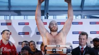 Tyson Fury and Wladimir Klitschko fight on after canvas row - BBC Sport