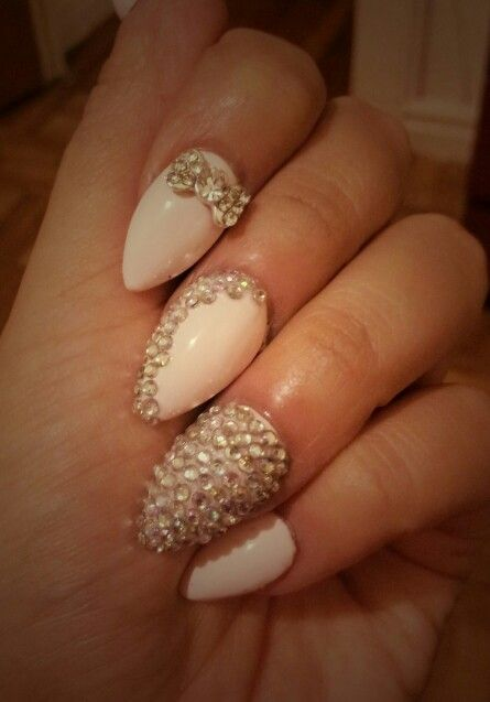 Stiletto nails with bows and rhinestones