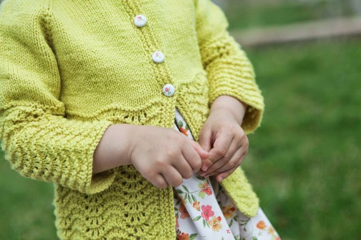 Handknit sweater with WoolyMossRoots fabric buttons.......... by Ngo Family Farm: an Easter sweater