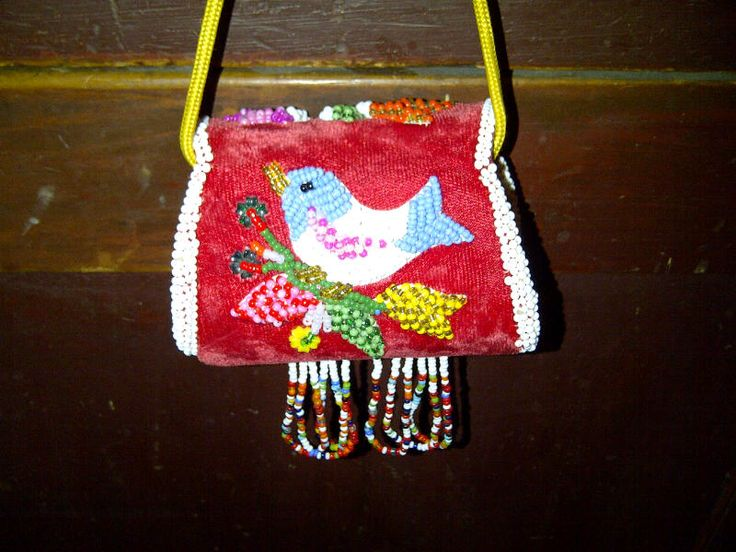Neat little beaded purse, decorated with a blue and white bird. Made about 1960.