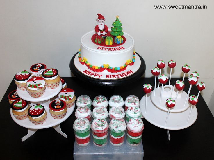 Christmas theme dessert/sugar table with designer cake, cupcakes, cake pops, push pops for boy's 1st birthday at Pune