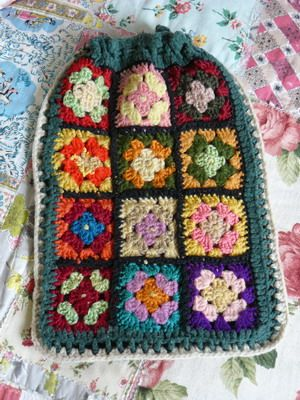 Hot water bottle cover, patchwork squares. No pattern.