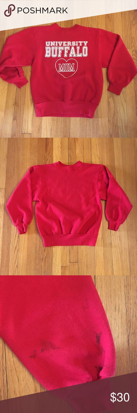 "Vintage Buffalo University Mom Sweatshirt I'm not a mom but I'd gladly rock this darling vintage sweatshirt! Worn in red cotton material but not worn out! Only condition issue is dark stain on one sleeve (see last photo). You could always cut the sleeves and make a short sleeved sweater to fix that. Best fits a size small. Fitted on a M and oversized on XS. 23"" long and 19"" bust when laying flat. Vintage Tops Sweatshirts & Hoodies"