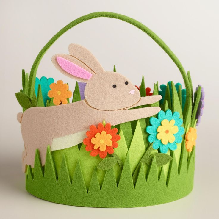 Crafted of felt in bright spring colors, our exclusive oval Easter basket features an adorable bunny and garden filled with beautiful flowers. >> #WorldMarket Easter Baskets