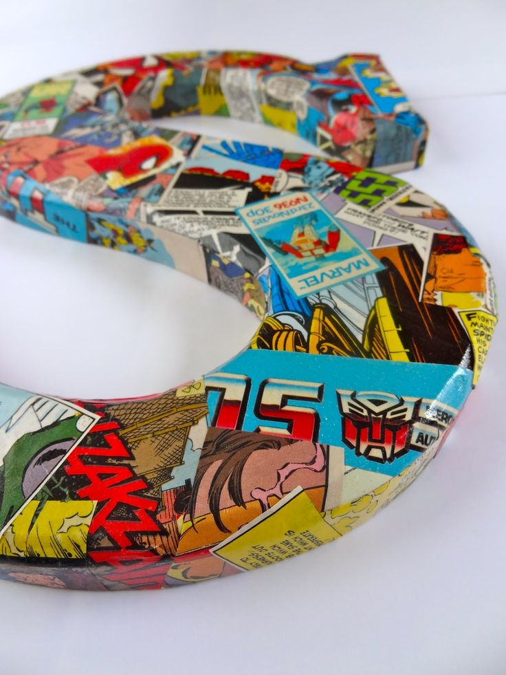 decopage wooden letters with comic books. Could be done with cardboard letters too and pictures of the graduate