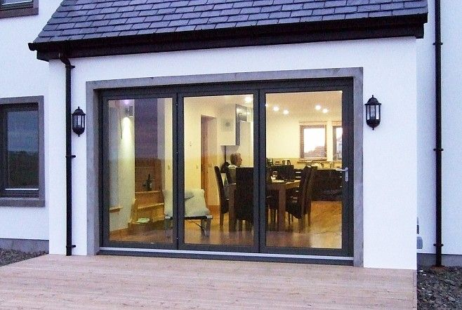 Black Bi fold doors using the SFK82 aluminium and timber folding door system