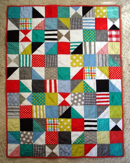 Modern Baby Quilt via blempgorf: almost a one-patch quilt with a few HST and QST here and there.  Love the fabric combination