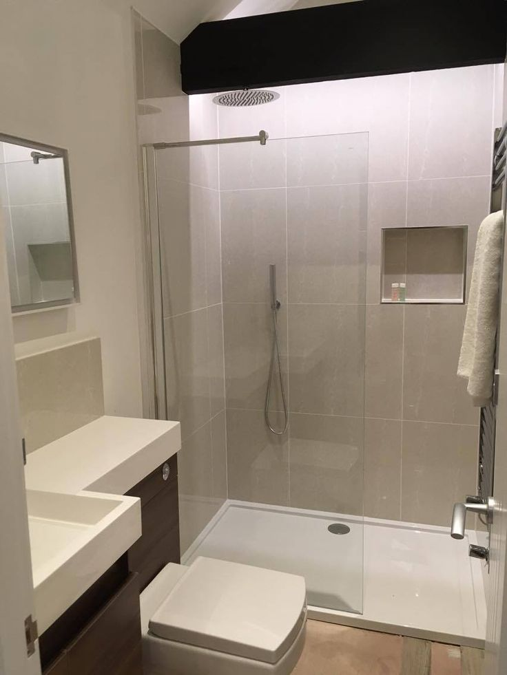 Make the most of the space you have in your small bathroom by combining a combination toilet and basin unit with a walk-in shower enclosure.