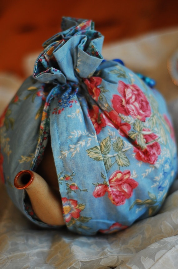 Reversible fabric tea cozy with an elastic bottom.