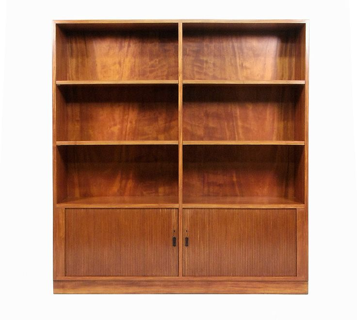 A stylish 1960s Danish flame mahogany shelving unit with sliding tambour doors.   It is fully refinished to pristine condition. The doors are inset with sculpted rosewood handles, each shelf adjustable to three positions.   The cupboard interior is finished in maple, also in beautiful, clean condition.   This tall and impressive unit combines practicality with beauty, typical of Danish furniture of the period.