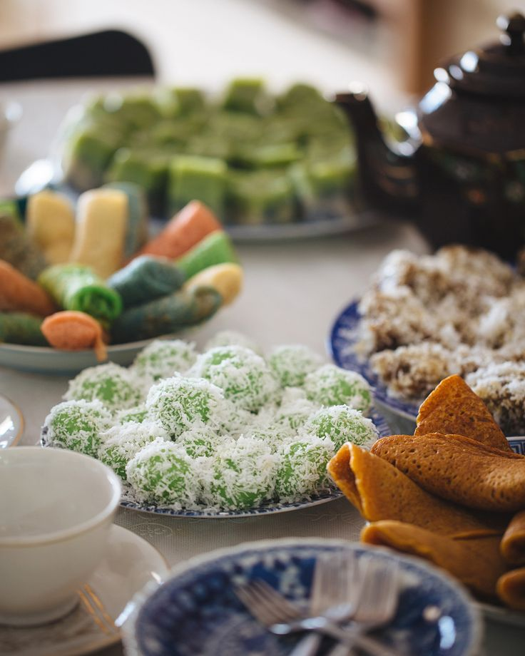 """""""Kuehs are common snacks of the Hokkien, Teochew and Peranakan cuisine. The terminology is actually a general description for bite-size nibbles. These traditional delights come in many different forms and are either sweet or savoury. Ondeh Ondeh are infused with pandan juice and filled with palm sugar, then rolled in coconut."""" Destination Flavour Singapore"""