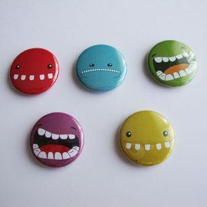 De Monstrueux badges