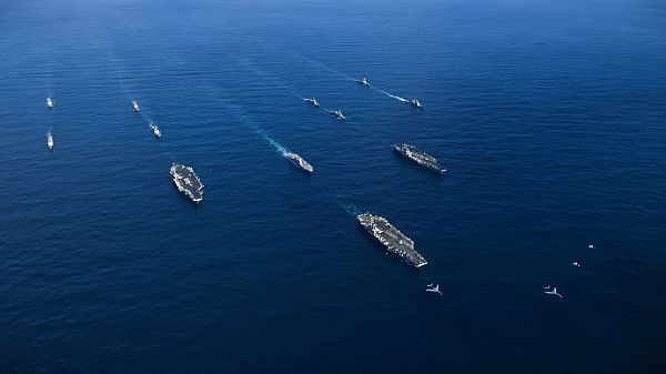 WESTERN PACIFIC (Nov. 12, 2017) U.S. Navy aircraft carriers USS Ronald Reagan (CVN 76), USS Theodore Roosevelt (CVN 71) and USS Nimitz (CVN 68) along with their strike groups transit the Western Pacific with ships from the Japanese Maritime Self-Defense Force. The strike groups are underway and conducting operations in international waters as part of a three-carrier strike force exercise.