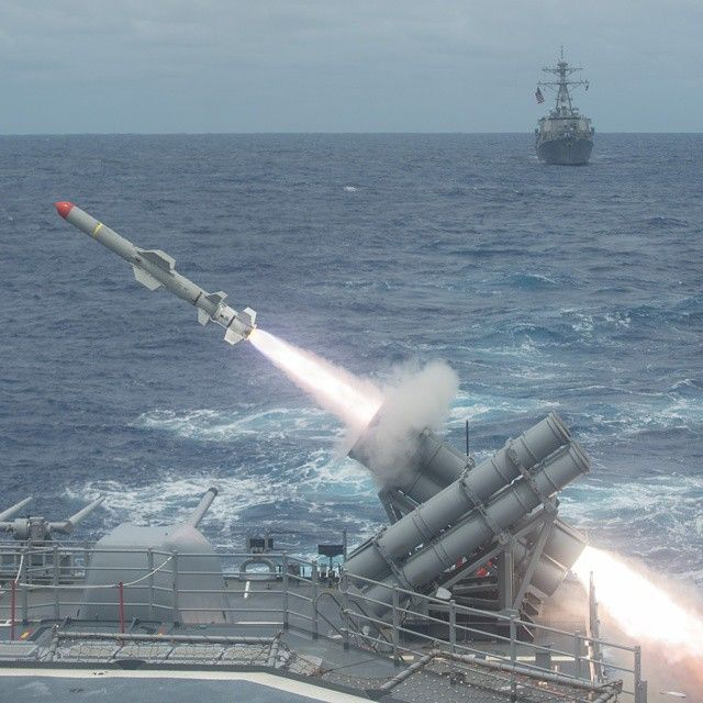 A Harpoon missile is launched from USS Shiloh (CG 67) during a live-fire…