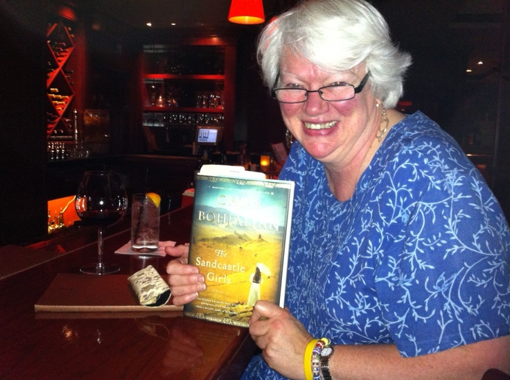 """Over the years, I have seen people reading my books on planes, trains, and in airports, but this was a first: A bar. Big thanks to this reader for bringing """"The Sandcastle Girls"""" with her to the bar at the Westin Hotel in Providence, RI."""