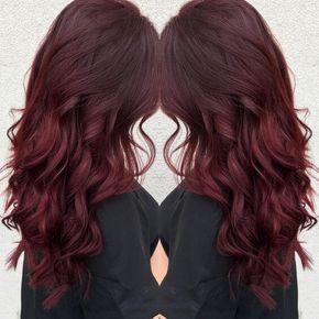 Wavy dark red hair with brown lowlights