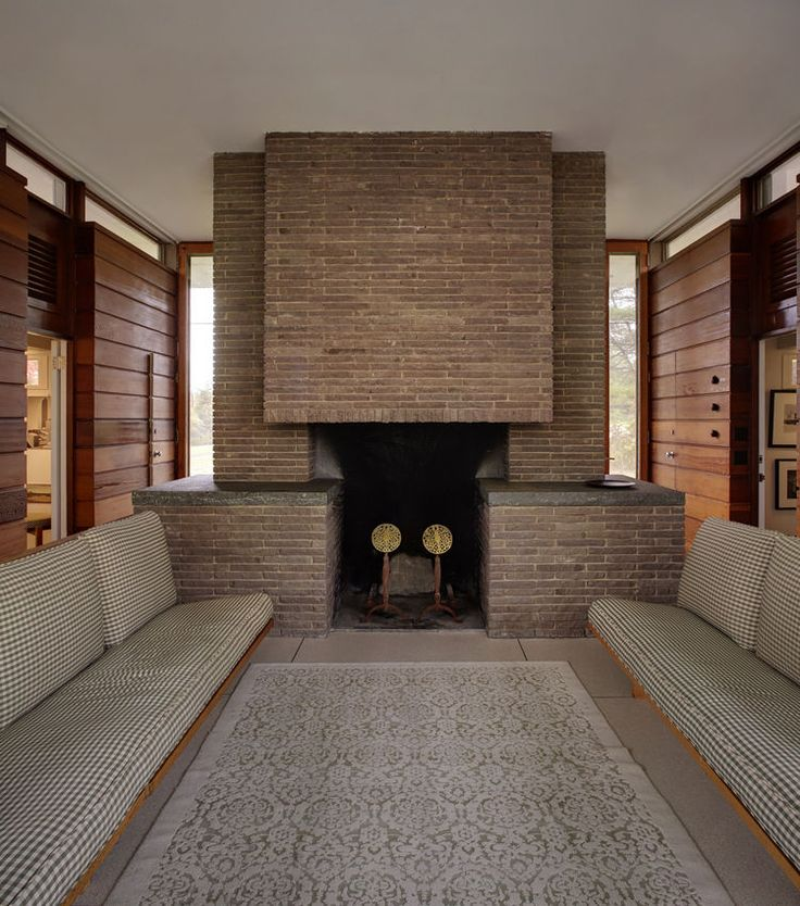 Midcentury fireplace in New Canaan - The small pavilion also houses a  dove-gray fireplace