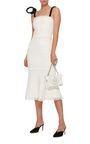 This **Oscar de la Renta** dress features a square neckline with cord ties and a fit and flare styled silhouette.