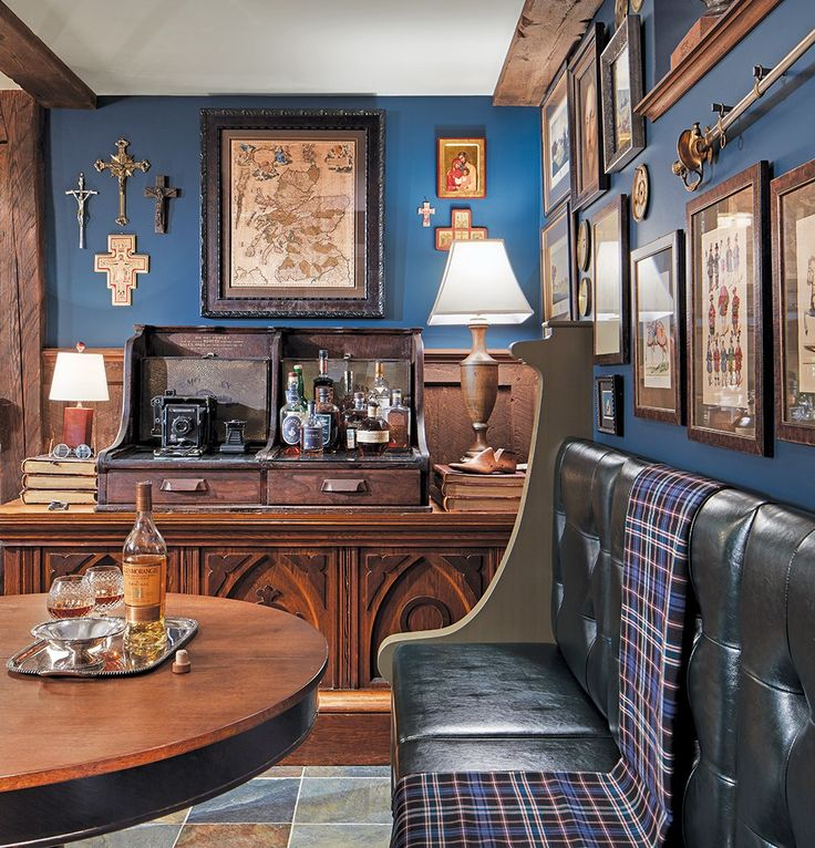 A Scottish-themed basement includes a repurposed church pew and altar, sword, vintage clock-face and coin collections, and large framed antique map of Scotland.  Here at Architectural Antiques, we think that this is an absolutely awesome idea for how to repurpose a bookie pay station into a classy bar. We have similar pay stations for sale online or in our store. Credit to Sandy LaMendola for the creative design and repurpose, Credit to Midwest Home magazine for the image post.