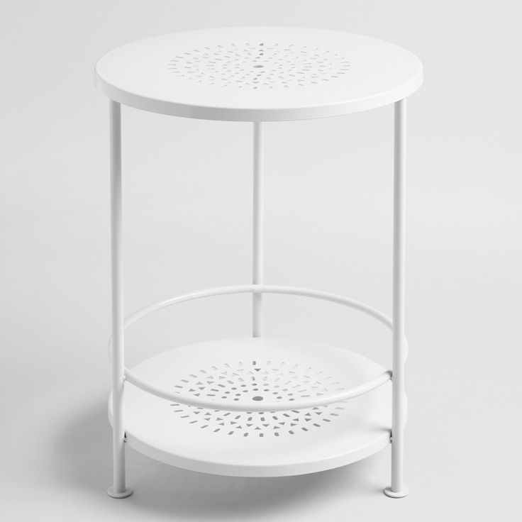 Detailed with a pierced motif, our versatile white accent table is perfect as a plant stand on the patio or in the garden.