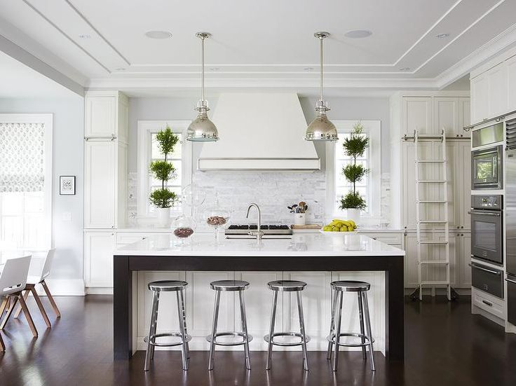 White And Gray Kitchen Features White Cabinets Paired With