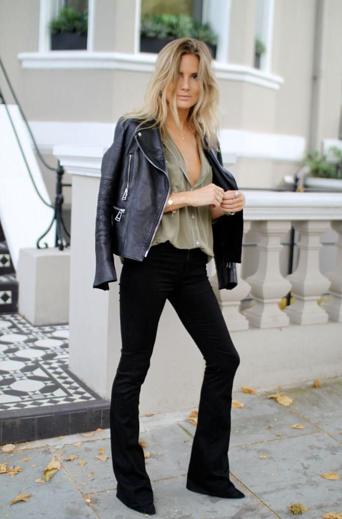 70 Modern Flare Jeans Outfit Ideas to Try This Spring -- black flare jeans worn with an olive blouse and black leather jacket