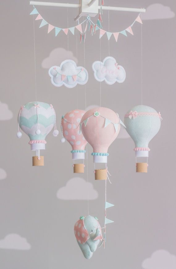 Aqua and Pink baby mobile. The photos show 4 hot air balloons floating under two puffy clouds and a baby elephant in coordinating fabrics. Each