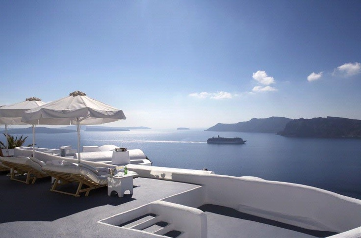 Perched on the Caldera cliffs, 100 meters above the azure waters of the Aegean, Katikies Hotel in Oia Santorini provides an experience of unparalleled romance and prestigious luxury.  http://www.guestus.com/Hotels-Santorini.asp