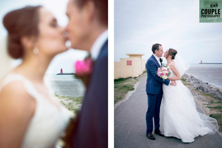The bride & groom with the Poolbeg Lighthouse in the background, where they had their first date. Weddings at Clontarf Castle Hotel by Couple Photography.
