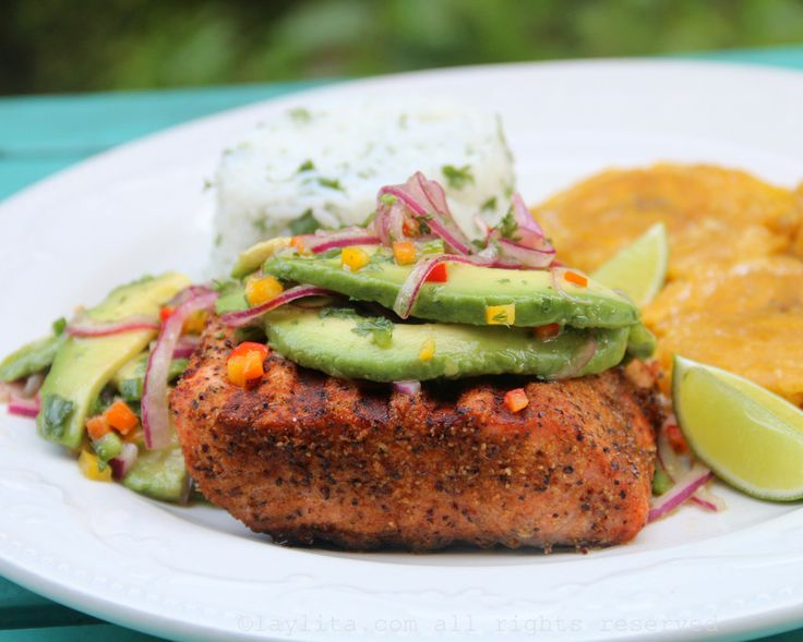 Recipe for grilled salmon with avocado salsa, the fish is seasoned with coriander, cumin, paprika, onion powder and pepper, and topped with avocado salsa.
