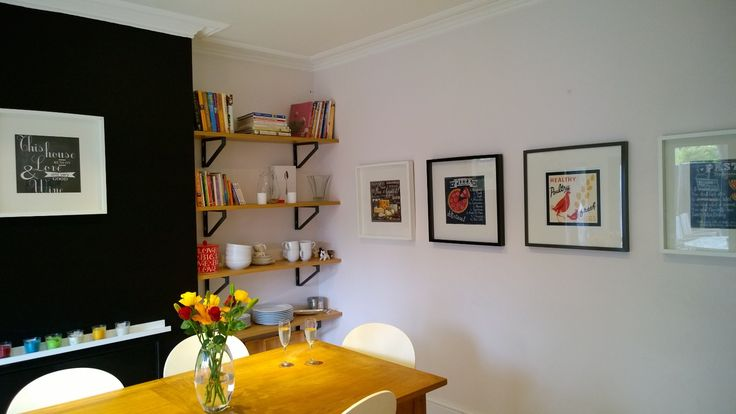bring depth to your kitchen with a black chalkboard wall, some shelves and some vintage like prints