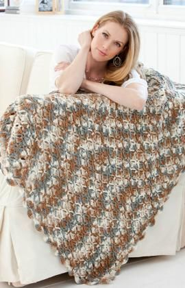 Stone Mountain Throw Crochet Pattern - For the naturalist, this easy crocheted lacy pattern adds just the right accent to your surroundings. The multi-color yarn is perfect for an interesting neutral throw.