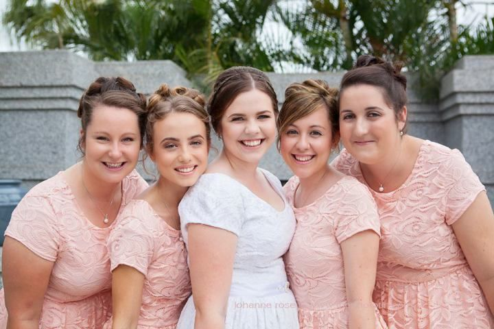 Sarah & her beautiful bridesmaids wearing the Samantha dress from Omika Australia. The sleeves were shortened to match Sarah's gown.