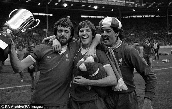 Liverpool's Mark Laurenson (l), Ronnie Whelan (c) and Bruce Grobbelaar (r) with the 'Milk Cup' that was briefly awarded alongside the traditional League Cup