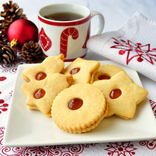Apricot Almond Jammie Dodgers - a tasty twist on a homemade version of the United Kingdom's favorite cookie. Ground almonds in the cookie dough pair perfectly with the sweet apricot jam but if apricot's not your favorite flavor, any good quality jam can be substituted.