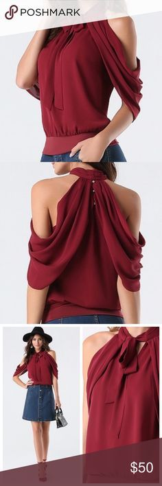 """Bebe Tie Neck Draped Cold Shoulder Top Maroon Red Elegant georgette top with graceful draped side accents, a chic tie neck and a relaxed blouson silhouette. Halter design keeps the look alluring. Back button-loop closure. Partially lined. 100% Polyester Machine wash Imported Center back to hem: 22.5"""" (57 cm) All items ship same day if purchased before 3:00 CST otherwise they will ship next day. Would trade for the same top in an XS, I received this as a gift and love it, but it's a little…"""
