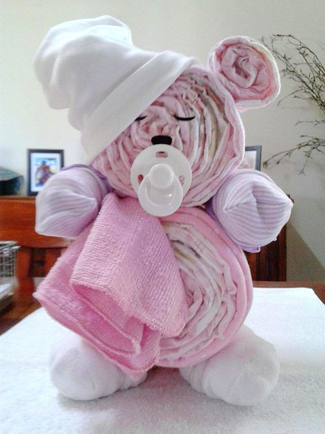 Teddy Bear Diaper Cake. Fun Baby Shower DIY Party Ideas and instructions for how to make cute diaper cakes!