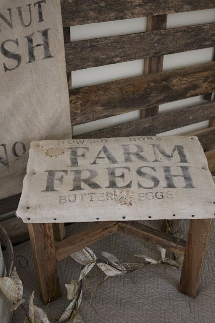 What's not to love about a prim stool covered with feed sack?!!!  Note how it's nailed on...Perfect!!