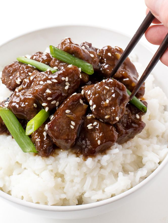 Amazing 30 Minute Mongolian Beef. Tender flank steakfried and tossed in a thick Asian inspired sauce. Way better than takeout!