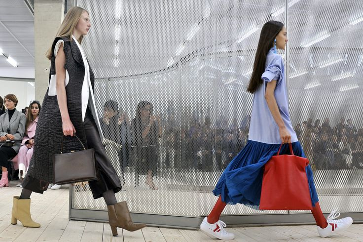 Céline's status as an accessories powerhouse is in no danger of slipping anytime soon. On Sunday's runway, Phoebe Philo proposed a carryall bag in a big way, as well as a smart, top-handle Fifties-era vintage-style bag. She also showed a series of mismatched shoes — a trend that's starting to emerge in Paris — and a new sneaker. Move over, Stan Smith — there's a new girl in town. — Roxanne Robinson