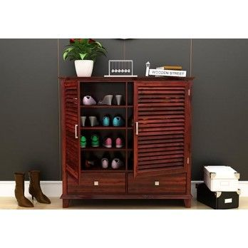 Buy #Velvic #Footwear #Rack With #Drawers in Mahogany Finish online at Wooden Street. Find extensive collection of stylish #living #room #cabinets to add more glorious charm to your living room. Shop Now @ https://www.woodenstreet.com/living-cabinets in #NaviMumbai #NewDelhi #Noida #PimpriChinchwad #Pune