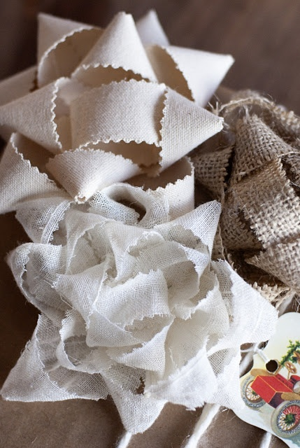 Make bows from scrap fabric. Similar way to make bows from maps or other scrap paper.