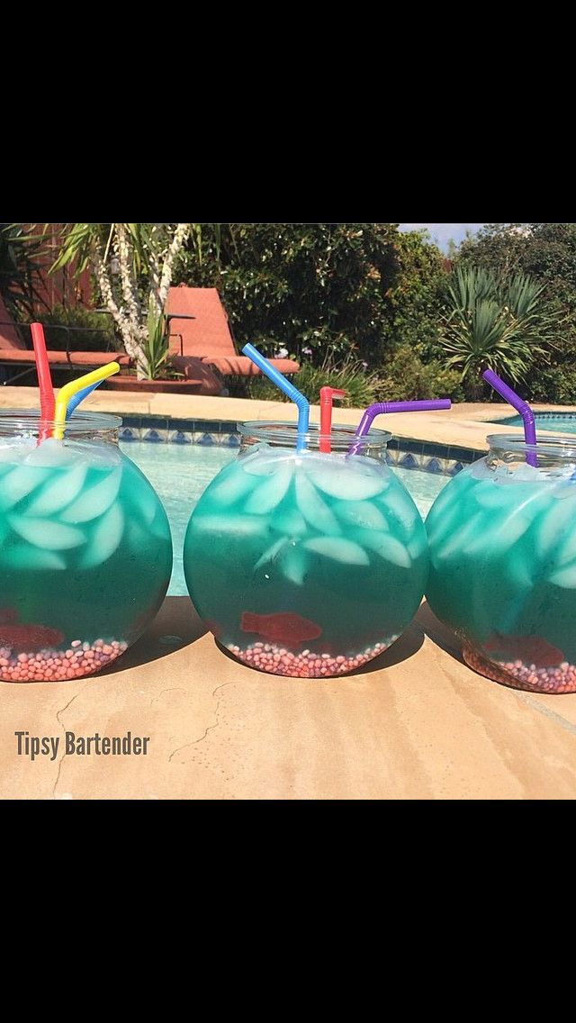 Fishbowl Punch  - 10oz Vodka  - 10oz Malibu Coconut Rum  - 6oz Blue Curacao - 12oz Sweet and Sour  - 20oz Pineapple Juice  - 32oz Lemon Lime Soda  - Nerds  - Swedish Fish - A few drops of Blue Food Coloring.  - I made a big batch of this and split it into smaller fish bowls.