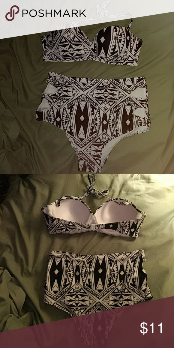 NEVER WORN High waisted bikini Never worn! This Aztec print high-waist bandeau bikini is perfect for a day at the beach or relaxing by the pool. The straps on the bikini top can be removed to avoid unwanted tan lines. The bottoms are extremely flattering, featuring side cut outs and a perfect shape for your bum. The cup size fits 34D-36D. Swim Bikinis