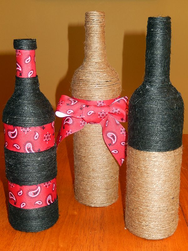 DIY: Try wrapping jute, yarn or ribbon around bottles for a simple, custom centerpiece. This is easy and fun!