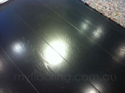 Solid black stain on European oak engineered wide board, finished with waterbase satin